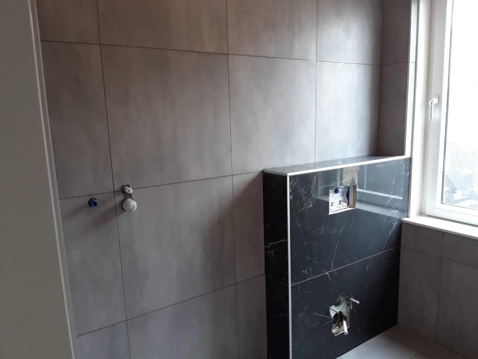 Tegelwerk badkamer en wc 2
